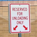 Reserved-For-Unloading-Parking-Lot-Sign